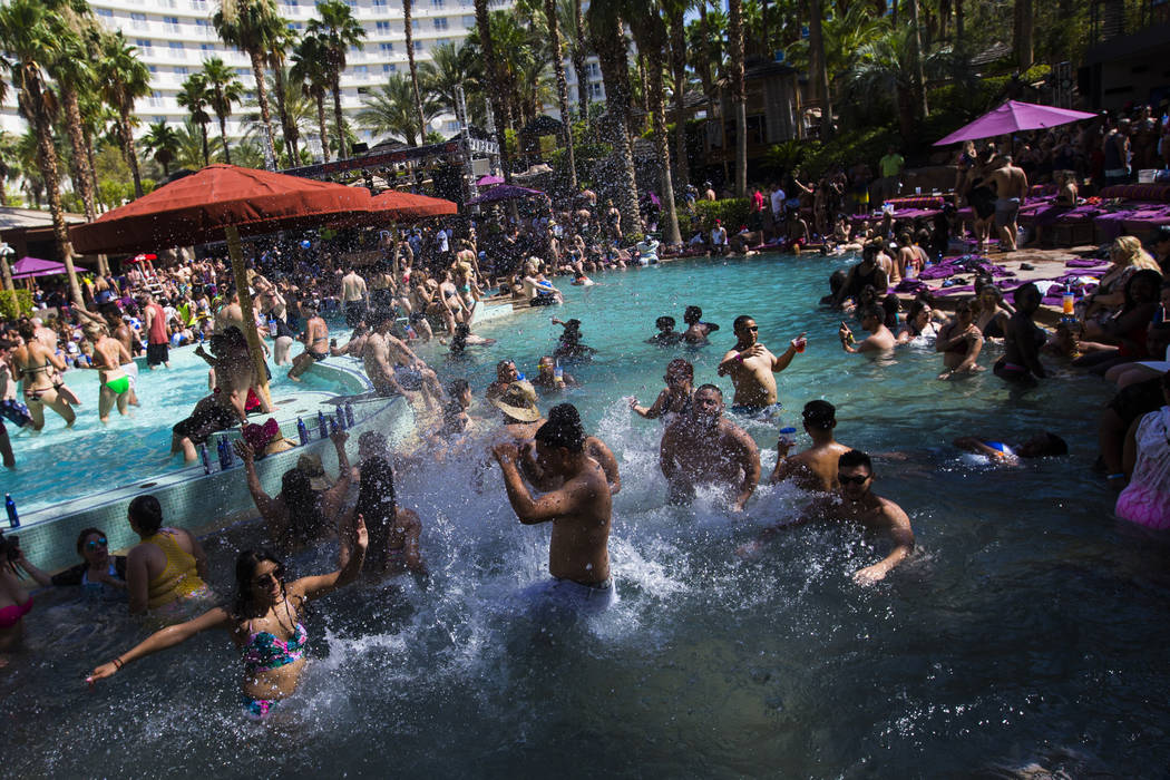 People splash and party in the pool at the Rehab dayclub at Hard Rock Hotel in Las Vegas on Sat ...