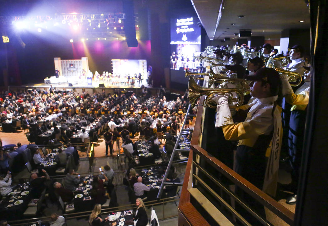 Members of the Arizona State marching band perform during the Las Vegas Bowl kickoff luncheon a ...