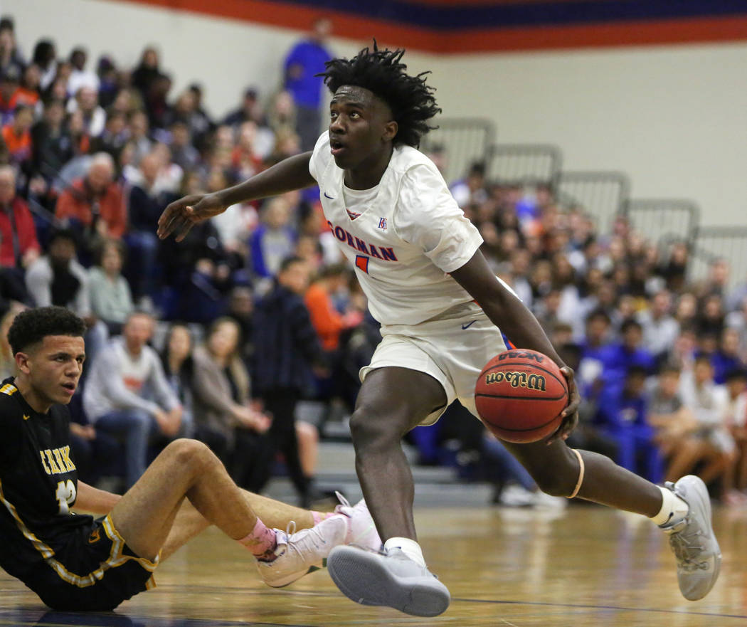 Bishop Gorman's Will McClendon (1) drives past Clark's Cameron Kimble (12) during the second ha ...