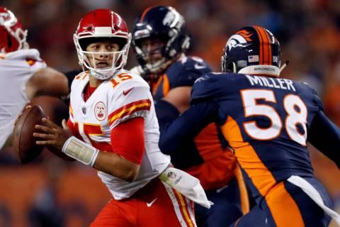 Kansas City Chiefs quarterback Patrick Mahomes (15) scrambles as Denver Broncos linebacker Von ...