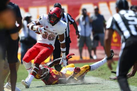 UNLV Rebels wide receiver Brandon Presley (80) is run out of bounds by USC Trojans cornerback G ...