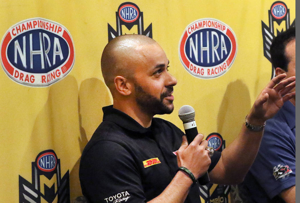 Funny Car driver JR Todd, left, speaks during a press conference on Thursday, April 4, 2019, in ...