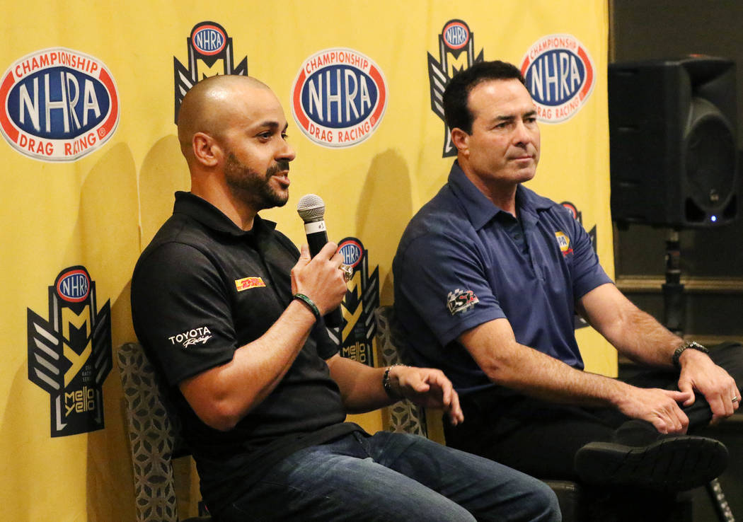 NHRA driver Ron Capps, right, listens as Funny Car driver JR Todd speaks during a press confere ...