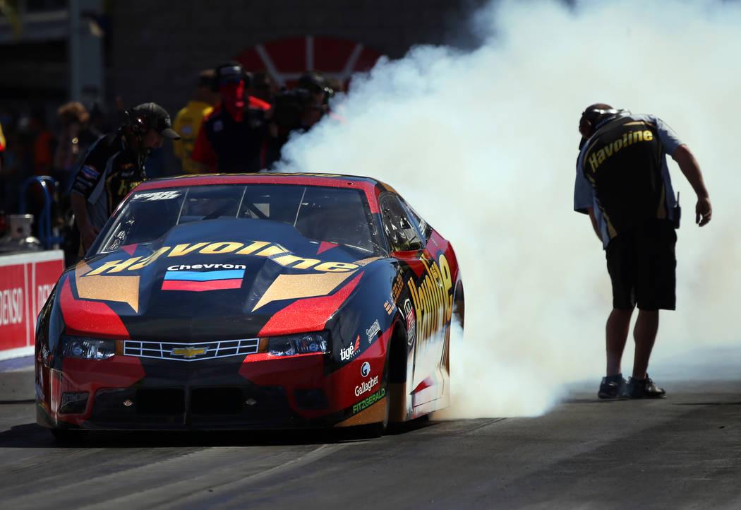 Pro Stock racer Alex Laughlin smokes the tires during the NHRA Mello Yellow Drag Racing Series ...