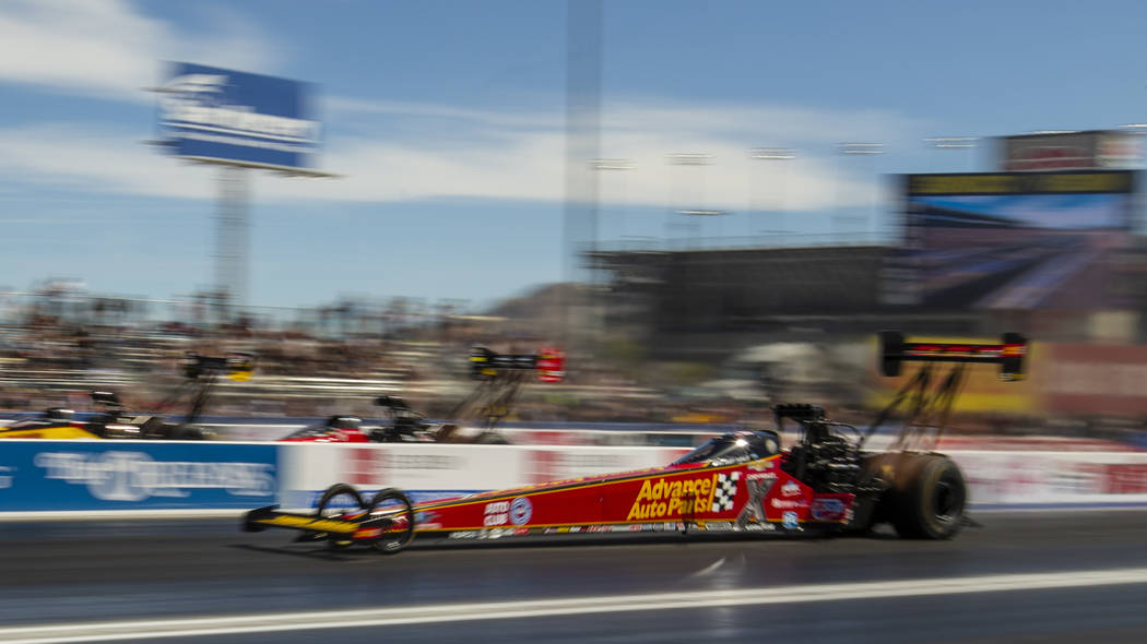 Top Fuel racer Brittany Force blasts down the track during the NHRA Mello Yellow Drag Racing Se ...