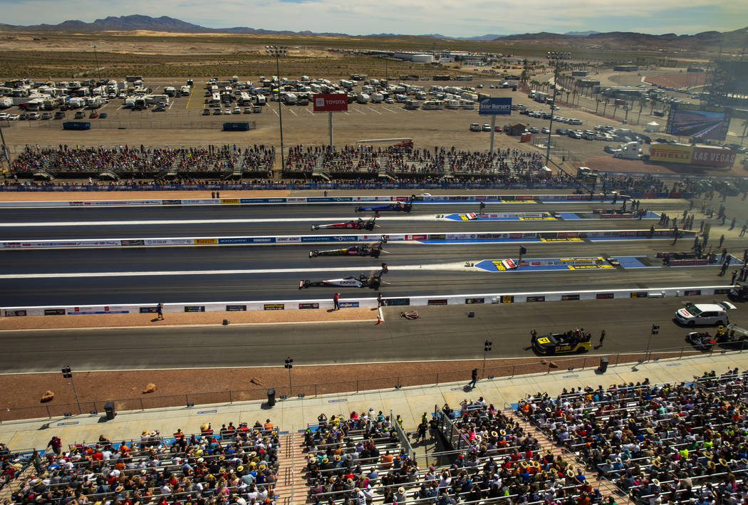 Top fuel cars race four across during the NHRA Mello Yellow Drag Racing Series on The Strip at ...