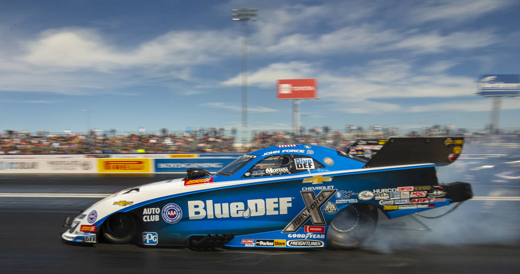 Funny Car racer John Force smokes the tires during the NHRA Mello Yellow Drag Racing Series on ...