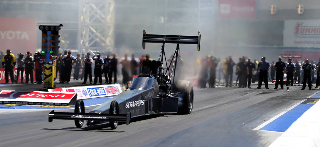 Top Fuel winner Mike Salinas leaves the start line during the NHRA Mello Yellow Drag Racing Ser ...