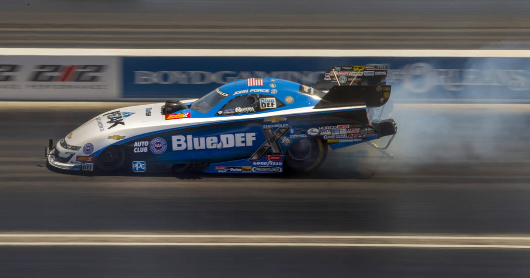 Funny Car racer John Force warms up the tires during the NHRA Mello Yellow Drag Racing Series o ...