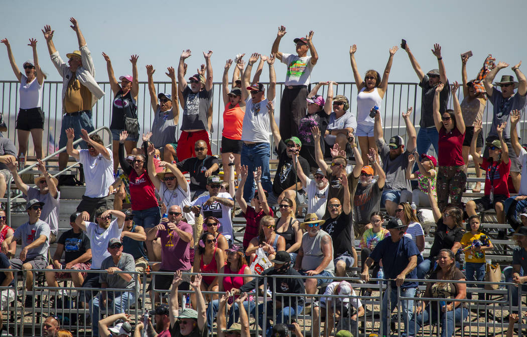 Fans get pumped up during the NHRA Mello Yellow Drag Racing Series on The Strip at the Las Vega ...
