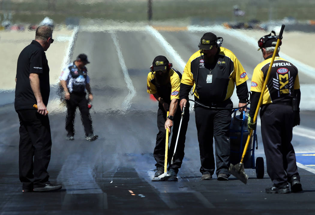 A track crew ensures it's ready for the next round during the NHRA Mello Yellow Drag Racing Ser ...