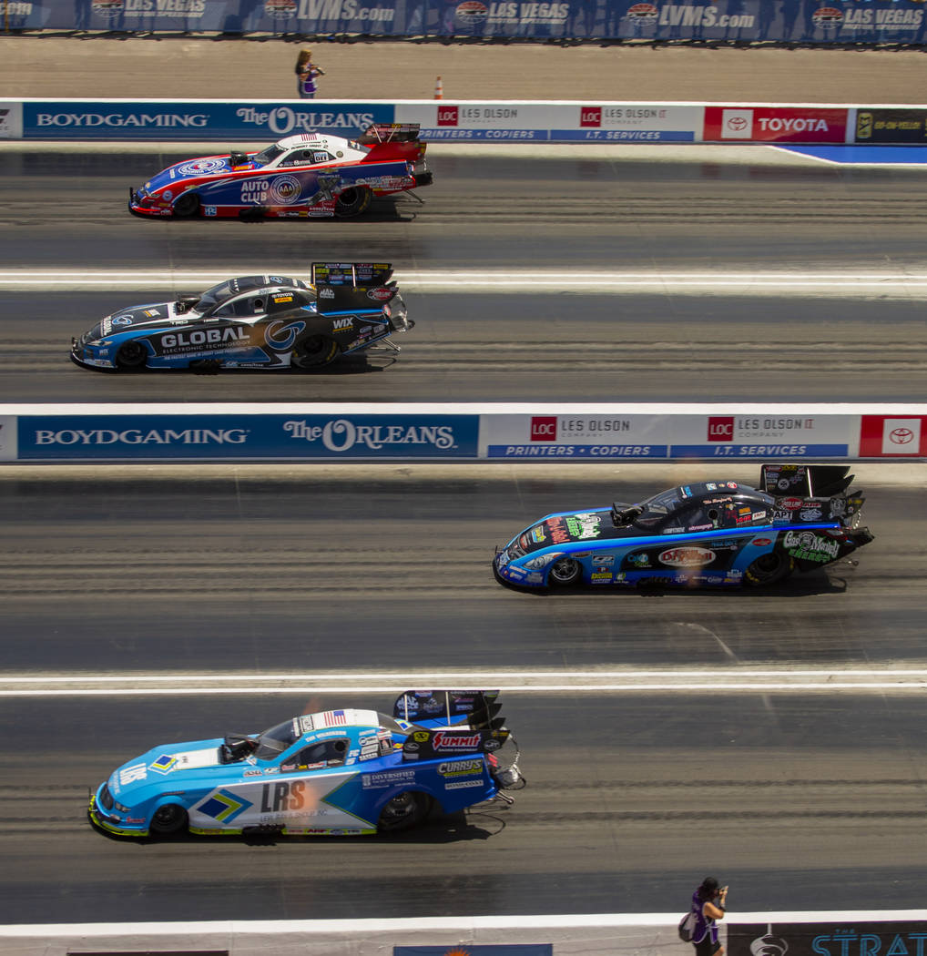 Funny Car racers compete four across during the NHRA Mello Yellow Drag Racing Series on The Str ...