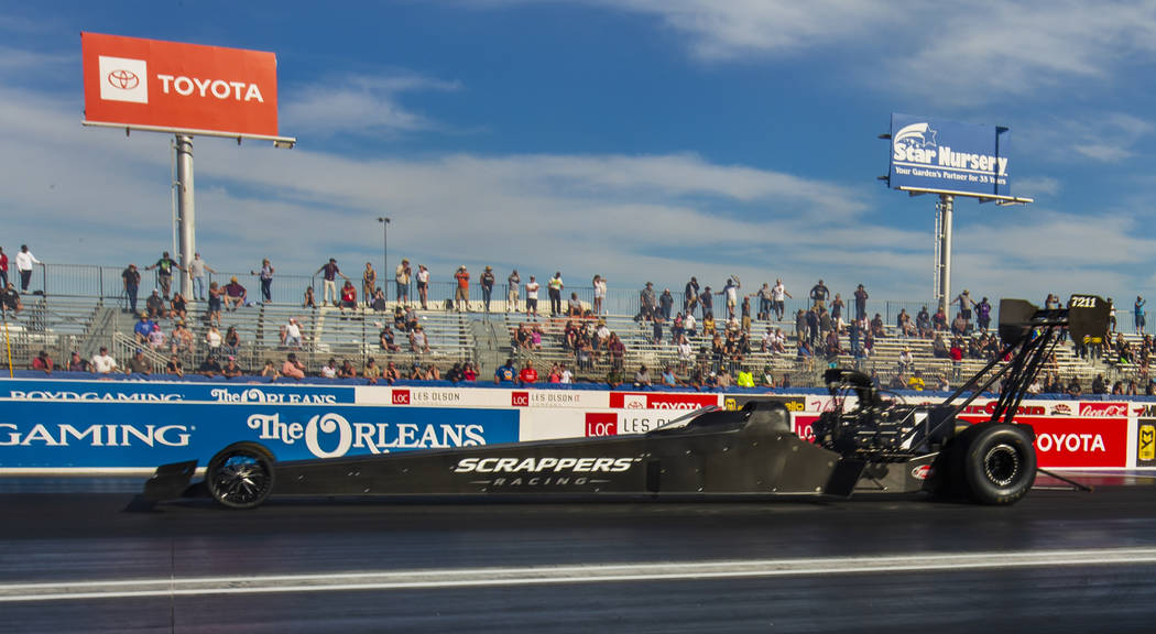 Top Fuel winner Mike Salinas cruises down the track to victory during the NHRA Mello Yellow Dra ...