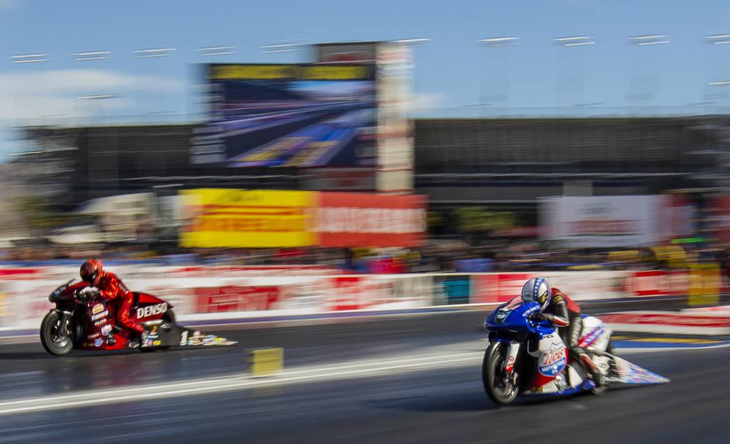 Pro Stock Motorcycle racers Matt Smith and winner Hector Arana Jr., battle in the finals is che ...