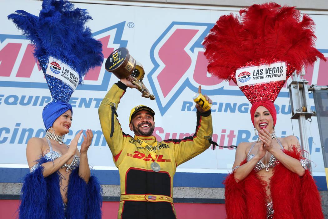 Funny Car winner J.R. Todd celebrates his victory during the NHRA Mello Yellow Drag Racing Seri ...