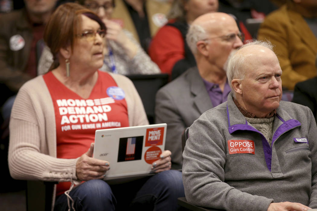 Diana Loring, of Reno, left, and Sandy Johnson, of Carson City, listen to testimony during a jo ...