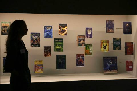 A member of British Library staff poses Oct. 18, 2017, for a picture with Harry Potter books pu ...