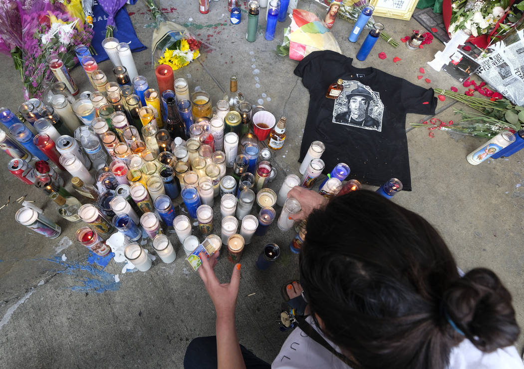 Fans of rapper Nipsey Hussle appear at a makeshift memorial in the parking lot of Hussle's Mara ...