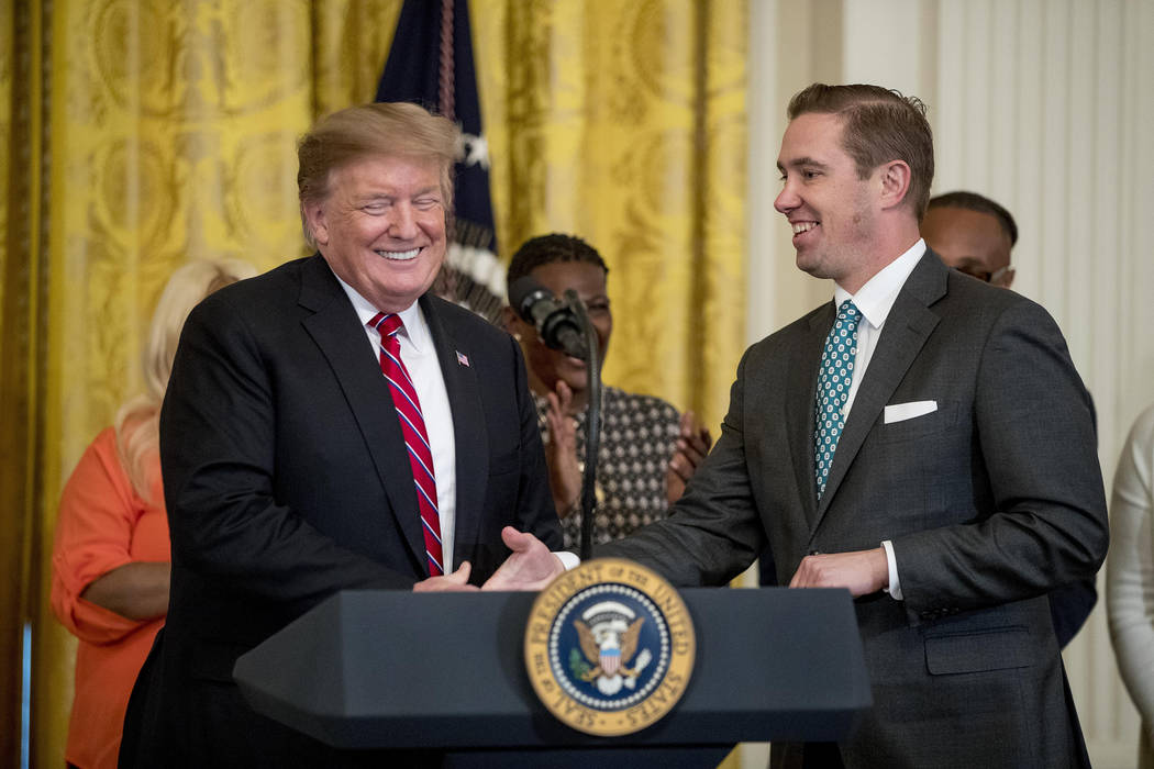 Former prisoner and law school professor Shon Hopwood, right, is invited to the podium by Presi ...