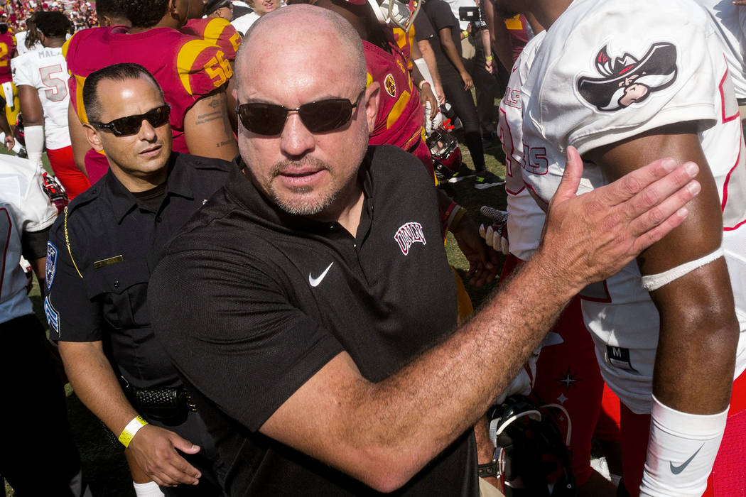 UNLV Rebels head coach Tony Sanchez leaves the field following after losing to the USC Trojans ...