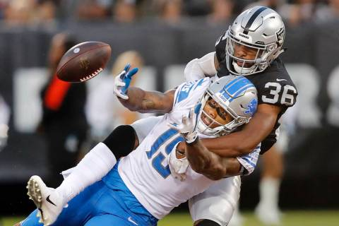 Oakland Raiders cornerback Daryl Worley (36) breaks up a pass intended for Detroit Lions wide r ...
