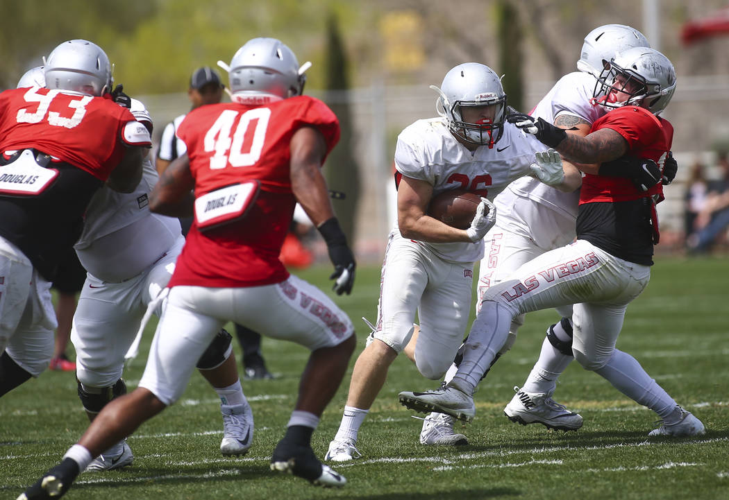 UNLV Rebels running back Chad Magyar (36) runs the ball during the spring football game at Pete ...