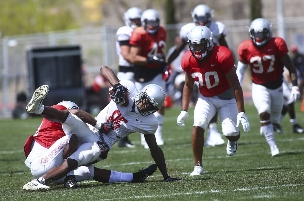 UNLV Rebels wide receiver Patrick Ballard (85) is taken down by running back Tyree Jackson duri ...