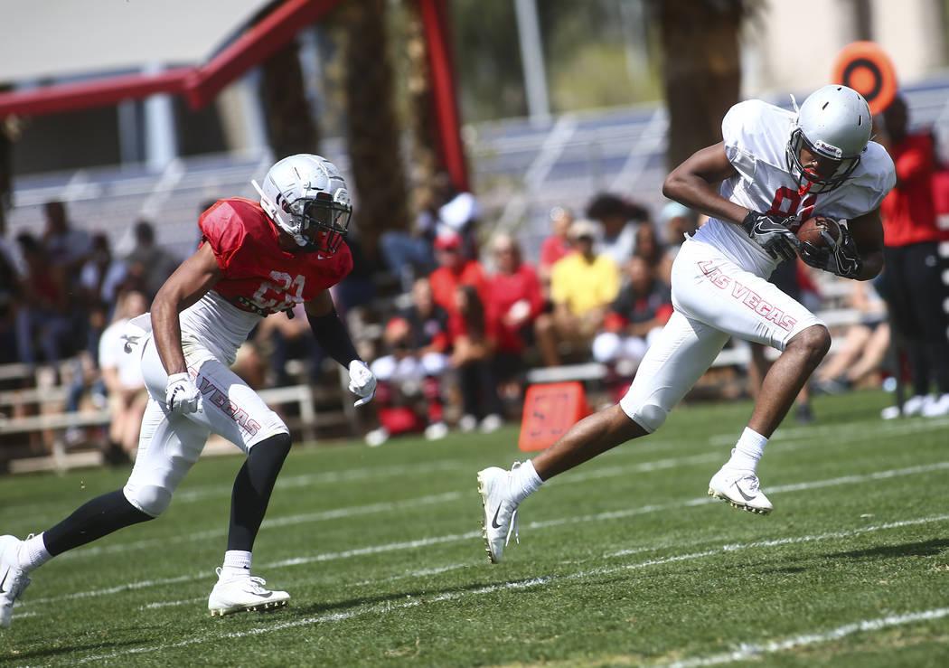 UNLV Rebels defensive back Demitrious Gibbs, left, chases after wide receiver Andre Collins Jr. ...