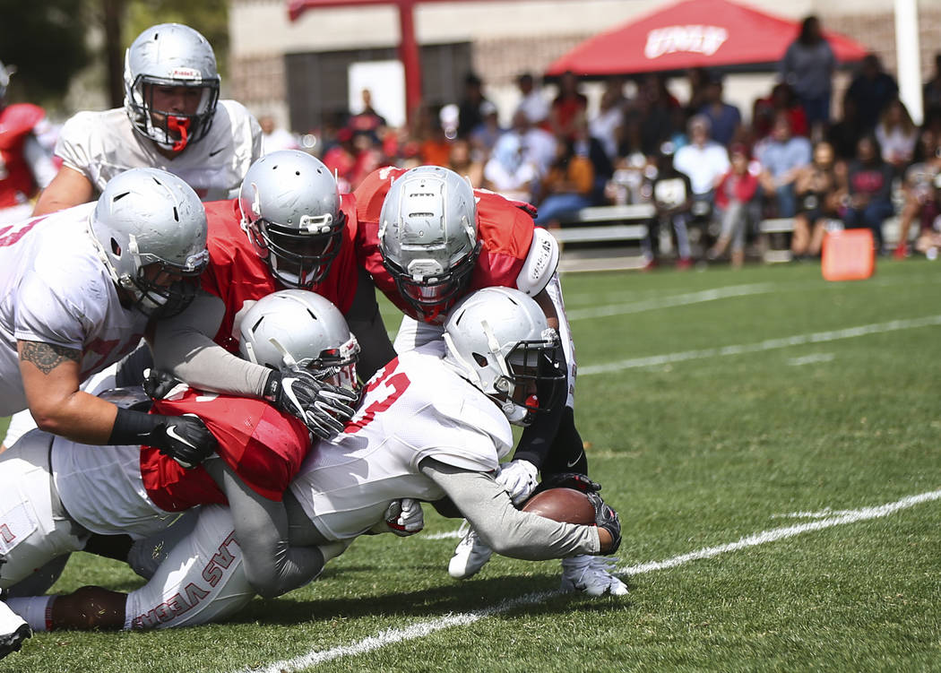UNLV Rebels defensive back Dalton Baker (33) scores a touchdown during the spring football game ...