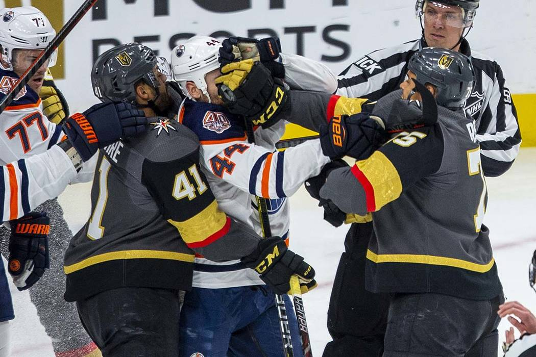 Golden Knights right wing Ryan Reaves (right) connects with a glove to the face of Edmonton Oil ...