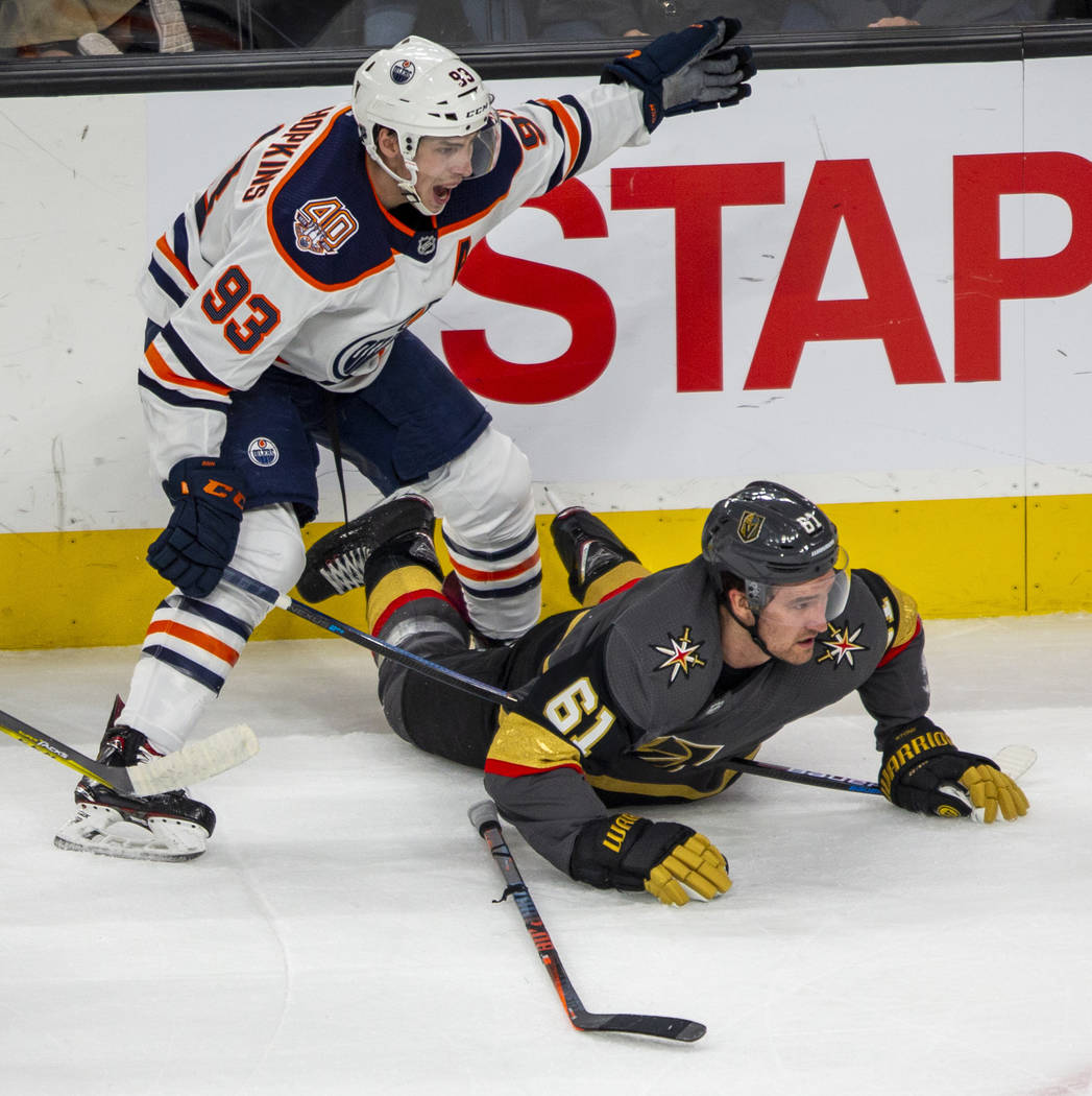 Vegas Golden Knights right wing Mark Stone (61) looks to the puck from the ice with Edmonton Oi ...
