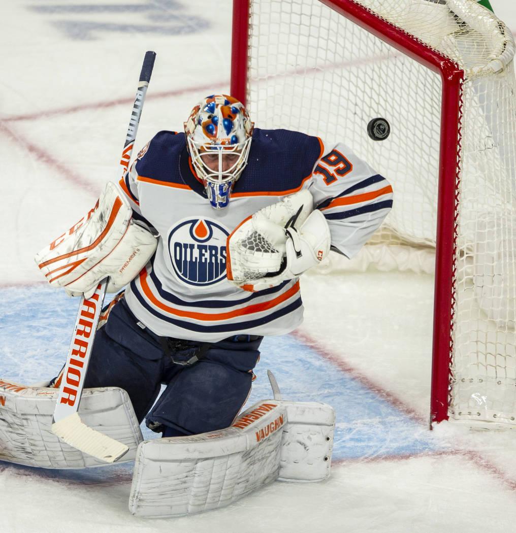 Edmonton Oilers goaltender Mikko Koskinen (19) deflects a shot on goal from the Vegas Golden Kn ...
