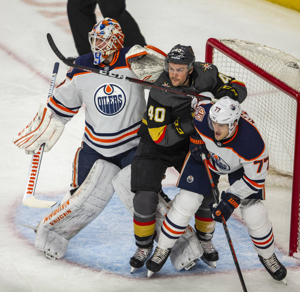 Edmonton Oilers goaltender Mikko Koskinen (19) battles Vegas Golden Knights center Ryan Carpent ...