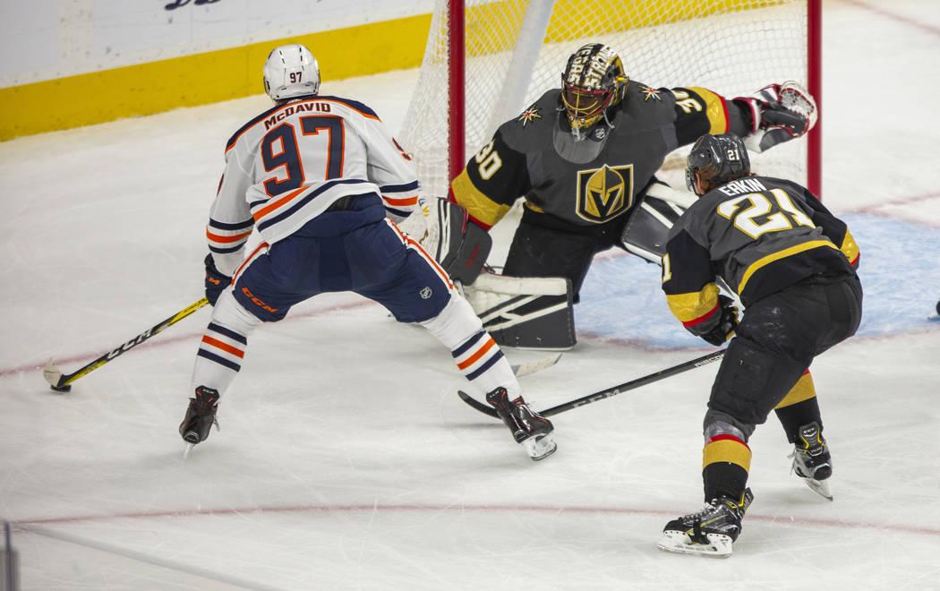 Edmonton Oilers center Connor McDavid (97) eyes the goal as Vegas Golden Knights goaltender Mal ...
