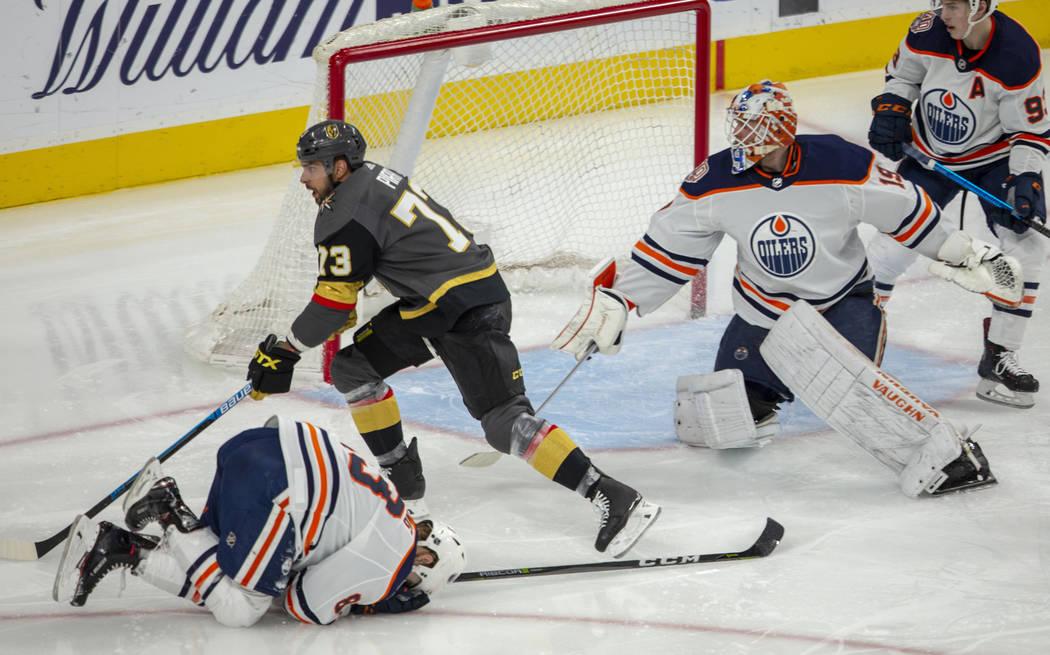 Edmonton Oilers defenseman Matt Benning (83) is down injured as Vegas Golden Knights center Bra ...