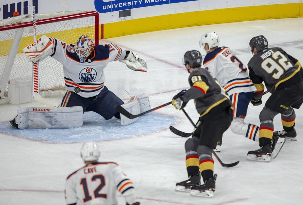 Edmonton Oilers goaltender Mikko Koskinen (19) takes a puck to the chest as Vegas Golden Knight ...