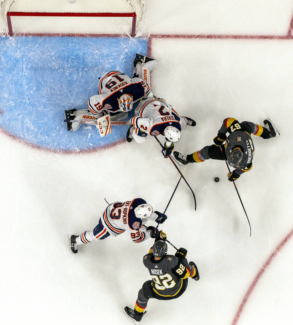 Vegas Golden Knights left wing Max Pacioretty (67) eyes a puck near the Edmond Oilers goal duri ...