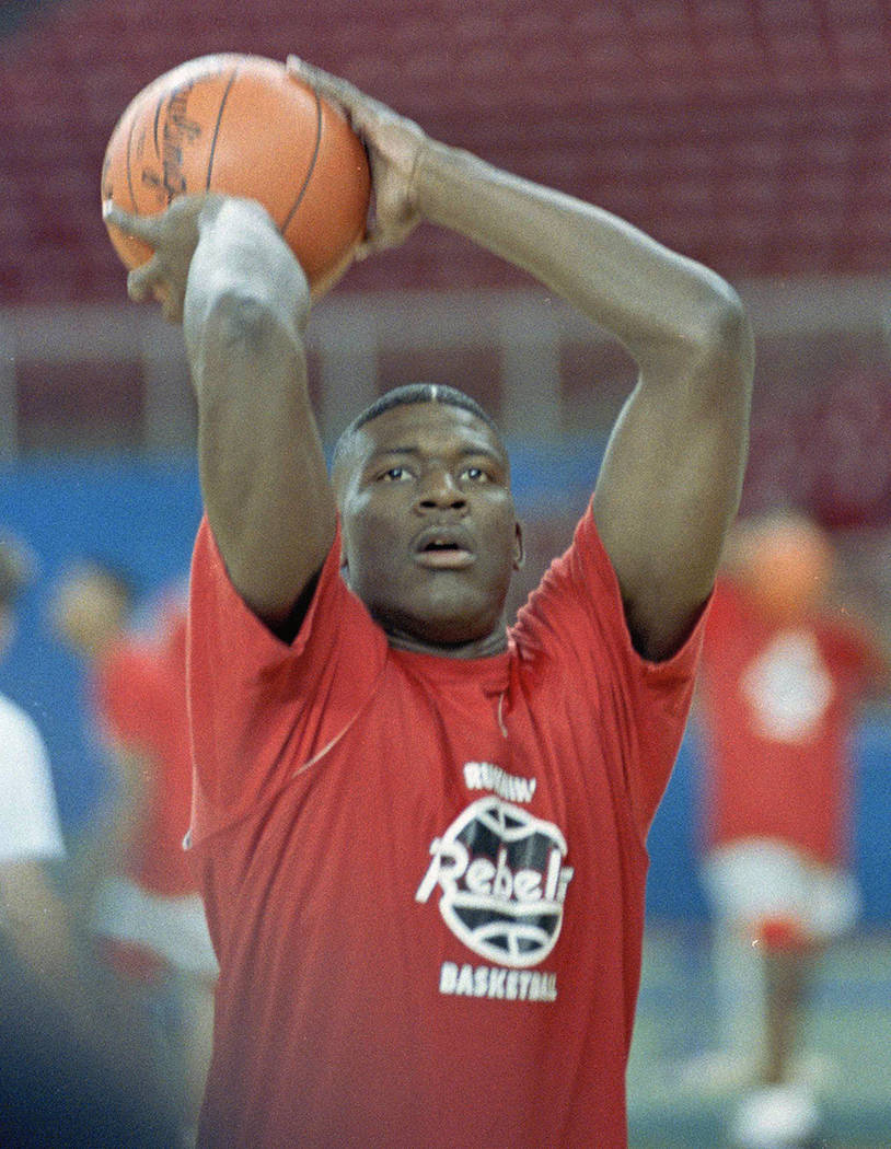 UNLV's Larry Johnson works out with teammates in Seattle in preparation for the game against Ut ...
