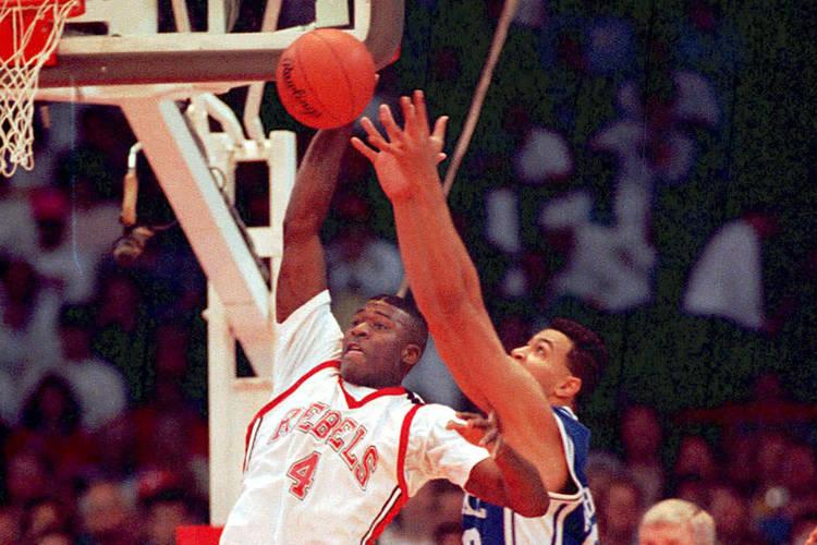 UNLV basketball forward Larry Johnson gets off shot beyond the defensive reach of Duke's Alaa A ...