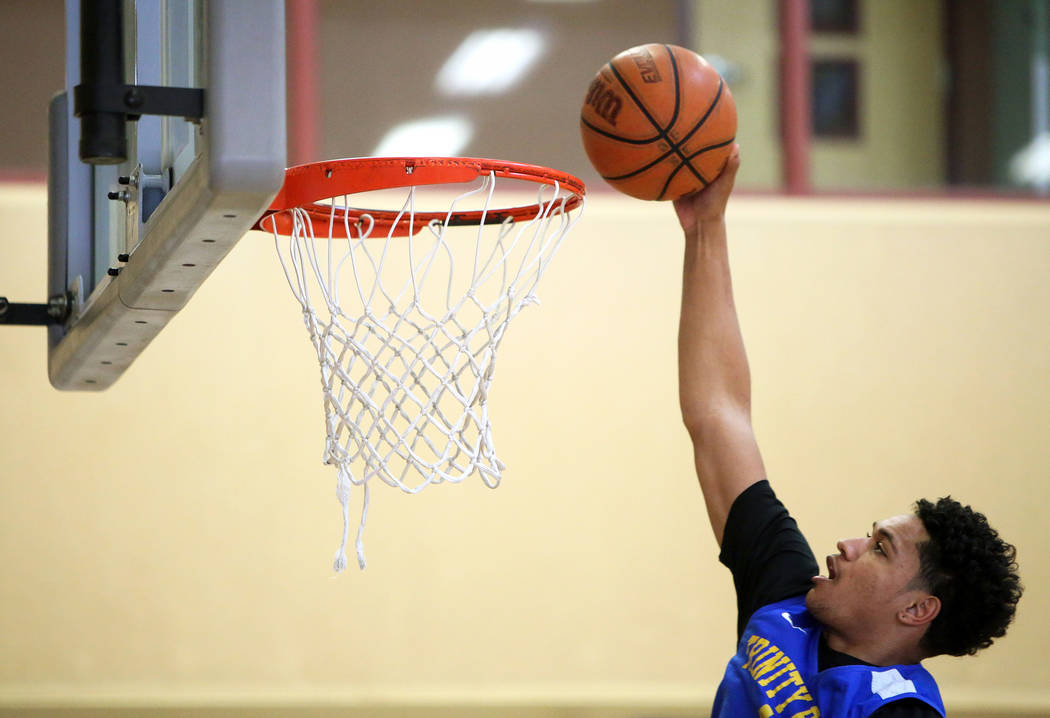 Trinity International junior Daishen Nix dunks the ball during a practice at the Bill and Lilli ...