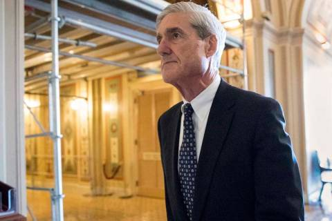 In this June 21, 2017, file photo, special counsel Robert Mueller departs after a meeting on Ca ...