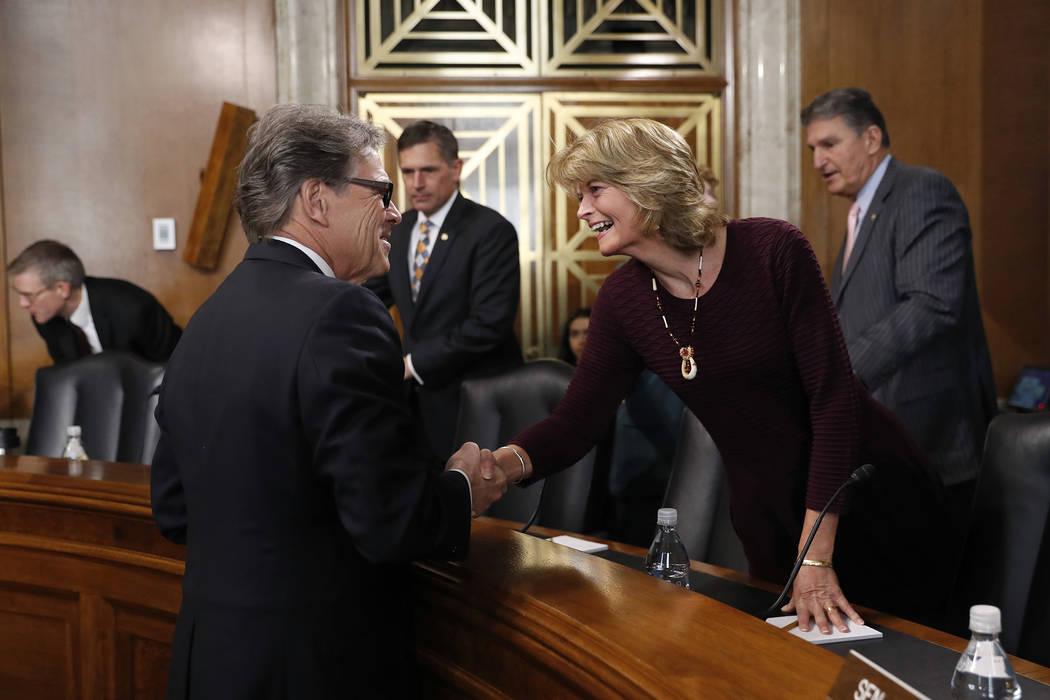 Energy Secretary Rick Perry, left, speaks with Sen. Lisa Murkowski, R-Alaska, chairwoman of the ...