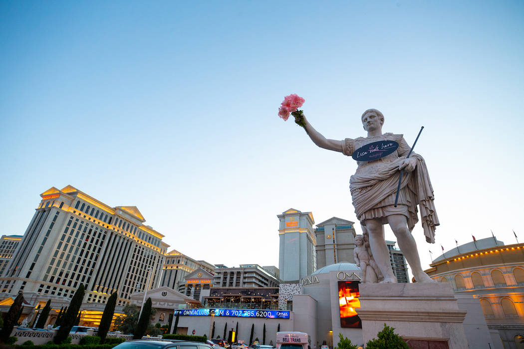 Caesars Palace's Roman statue on the Las Vegas Strip holds pink flowers in celebration of Lisa ...