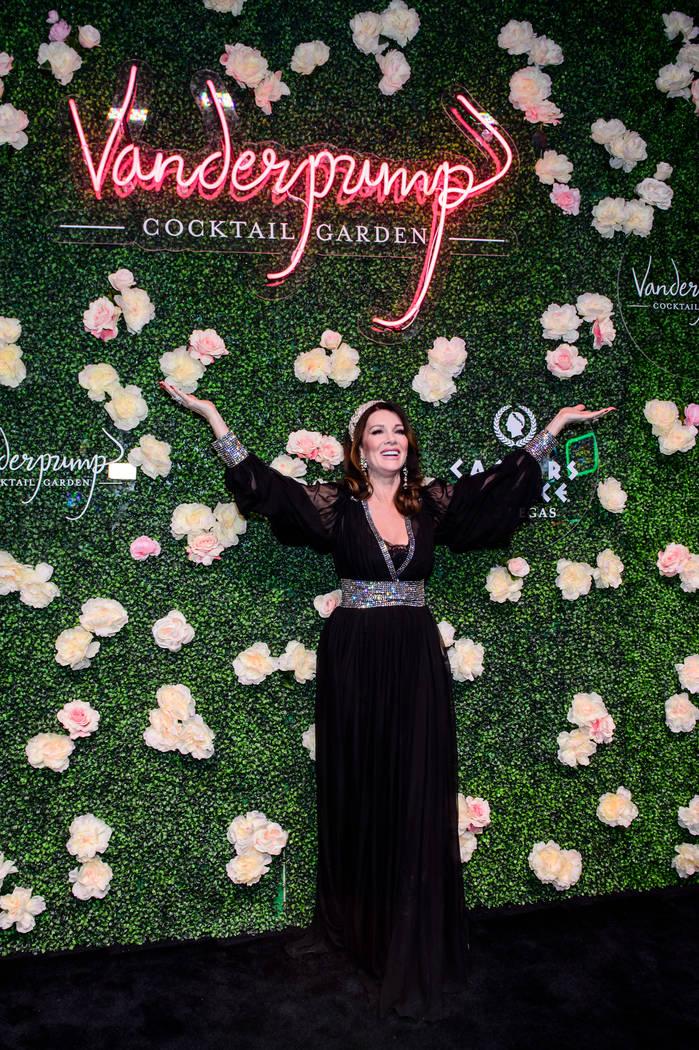 Lisa Vanderpump poses under a sign for her new Vanderpump Cocktail Garden at Caesars Palace. (C ...