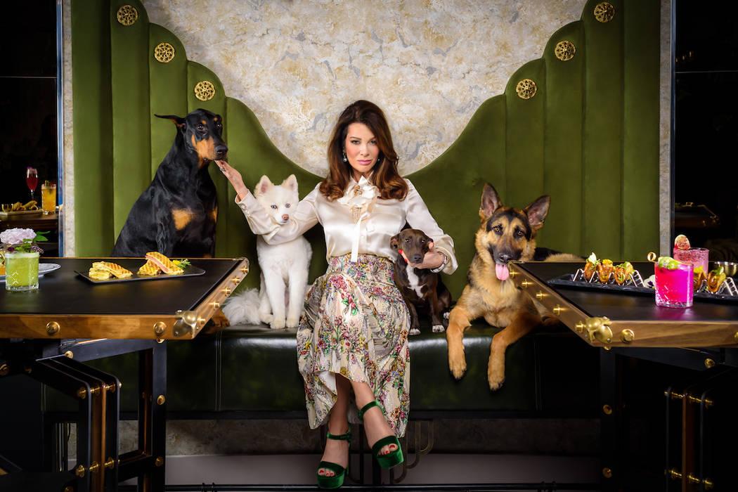 Lisa Vanderpump poses with dogs inside her Vanderpump Cocktail Garden at Caesars Palace. (Caesa ...