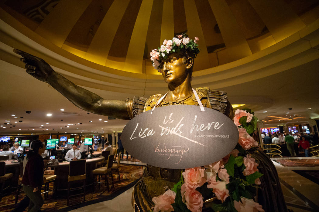 A statue inside Caesars Palace is adorned with pink roses in celebration of Lisa Vanderpump's n ...