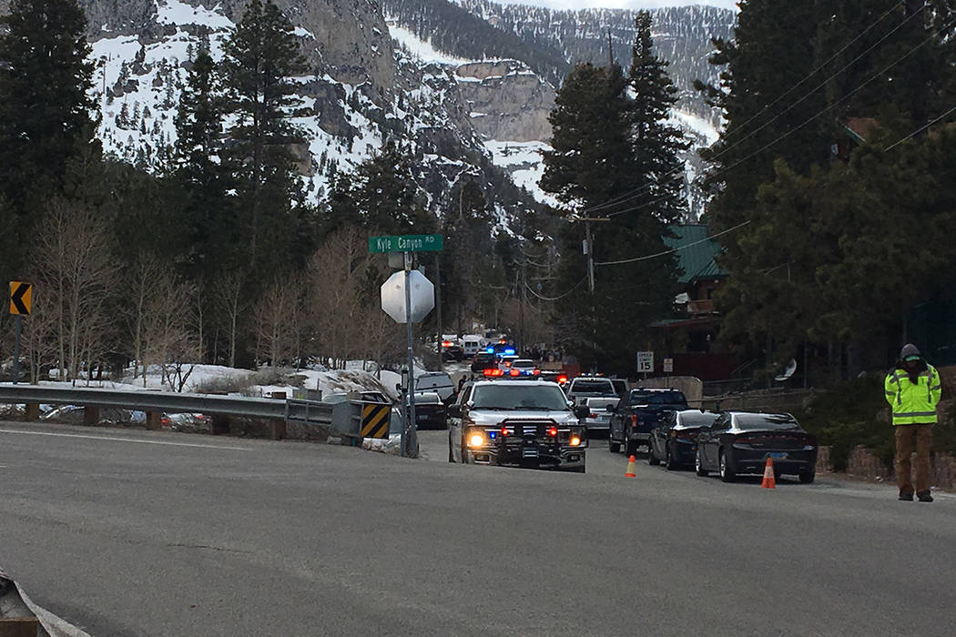 Police investigate a shooting involving Nevada Highway Patrol troopers Tuesday, April 2, 2019, ...