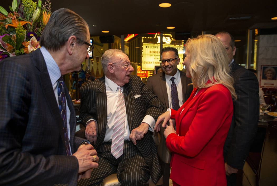 Former Las Vegas Mayor Oscar Goodman chats with his daughter Cara and other while standing in f ...