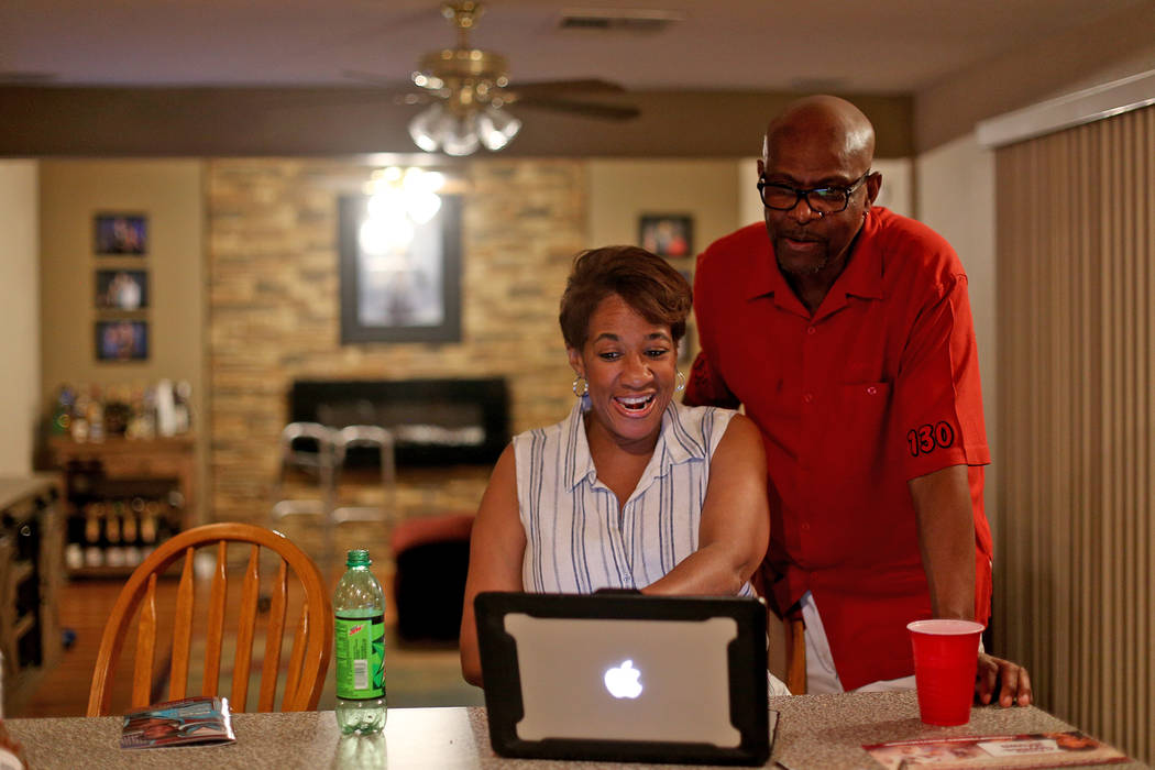 Councilwoman Pamela Goynes-Brown smiles with her husband Romero Brown as they look at results a ...