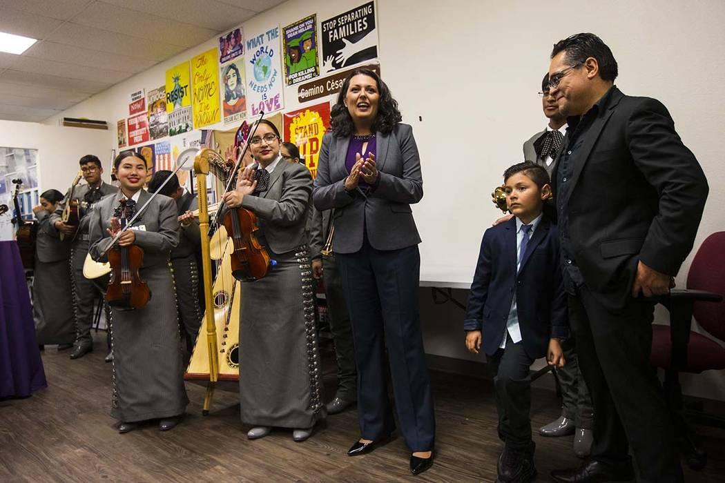 Former assemblywoman Olivia Diaz, a Las Vegas City Council candidate for Ward 3, center, addres ...